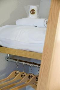 A bed or beds in a room at B&B Hôtel Paris Porte de la Villette