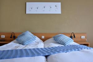 Ein Bett oder Betten in einem Zimmer der Unterkunft Hotel Truida