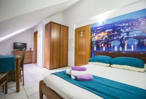 Postel nebo postele na pokoji v ubytování Pension Palac