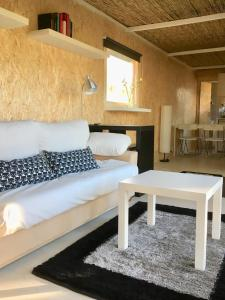 A bed or beds in a room at Relax Container