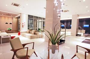 The lobby or reception area at Ibis Styles Brasília Aeroporto
