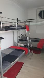 A bunk bed or bunk beds in a room at Lisbon Hostel Terminal 3