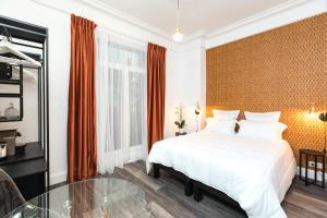 A bed or beds in a room at Arome Hotel