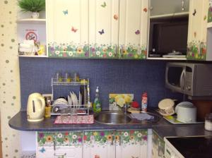 Кухня или мини-кухня в Apartment on Lyzhnaya 5