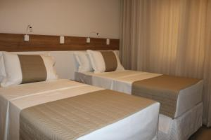 A bed or beds in a room at Bristol Aline
