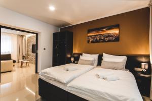 Postel nebo postele na pokoji v ubytování SILESIA Apartment