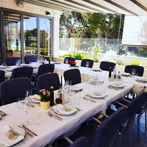 A restaurant or other place to eat at Rooms Rogač
