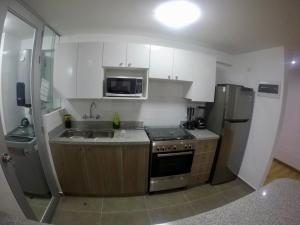 A kitchen or kitchenette at Casona Apartament