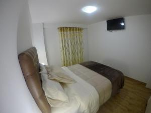 A bed or beds in a room at Casona Apartament