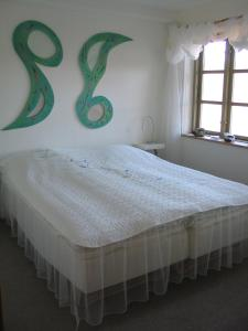 Ein Bett oder Betten in einem Zimmer der Unterkunft Bakkegaard Møns Klint