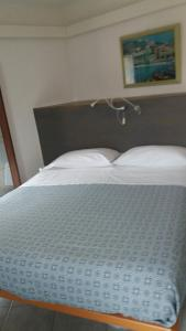 A bed or beds in a room at Affittacamere Elisabetta