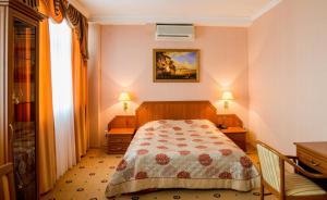 Кровать или кровати в номере Отель Профит