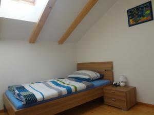 Ein Bett oder Betten in einem Zimmer der Unterkunft Ritzhof