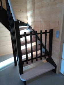 A bunk bed or bunk beds in a room at Mustikkakallio Luxury Villa