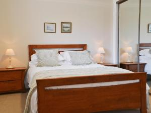 A bed or beds in a room at Trien Lodge