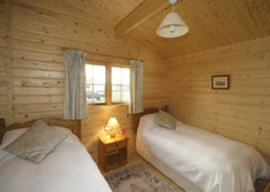 A bed or beds in a room at Field Lodge