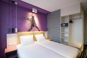 A bed or beds in a room at ibis Styles Haarlem City