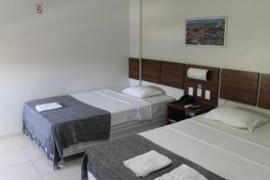 A bed or beds in a room at Hotel do Largo Manaus