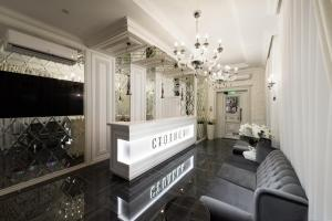 The lobby or reception area at Boutique-hotel Stolica