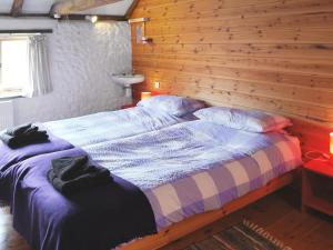 A bed or beds in a room at Chalk Barn