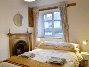 A bed or beds in a room at Lamont Cottage