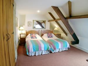A bed or beds in a room at Chetnole Mill