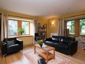 A seating area at Plantlymoss Cottage