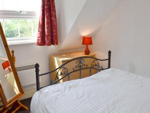 A bed or beds in a room at Hillcroft