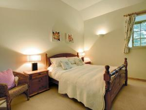 A bed or beds in a room at Coach House