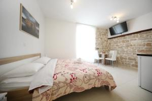 A bed or beds in a room at Sites of Zadar Apartments