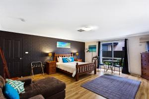 A bed or beds in a room at Salamander Beach Accommodation - Adults Only