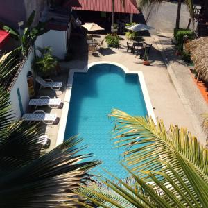A view of the pool at Hotel Tunco Lodge or nearby