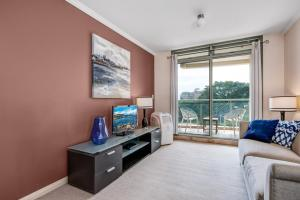 A television and/or entertainment center at Fabulous beach apartment