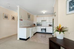 A kitchen or kitchenette at Fabulous beach apartment