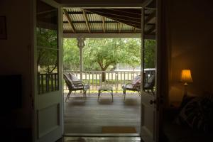 A balcony or terrace at The Carriages Boutique Hotel and Vineyard