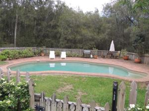 The swimming pool at or near The Carriages Boutique Hotel and Vineyard