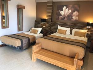 A bed or beds in a room at Hotel Colibri