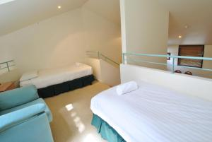 A bed or beds in a room at Oberdere 1