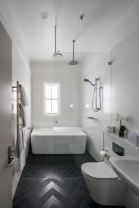 A bathroom at Mrs Banks Hotel