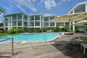 The swimming pool at or near Seascape Holidays at Beaches Port Douglas