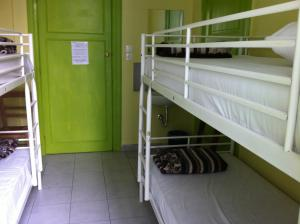 A bunk bed or bunk beds in a room at Zeus Hostel