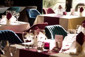 Ein Restaurant oder anderes Speiselokal in der Unterkunft Ara Hotel Comfort