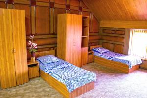 Кровать или кровати в номере Elit