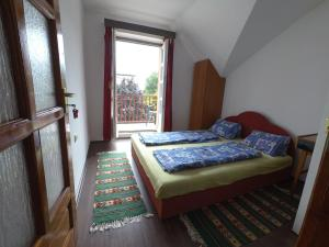 A bed or beds in a room at Barátság Ház