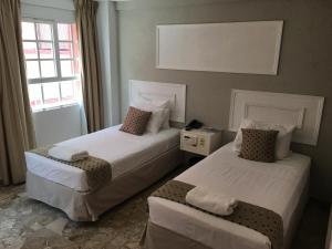 Cama ou camas em um quarto em San Marco Hotel Curacao & Casino