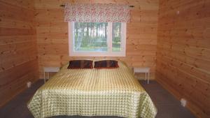 Vuode tai vuoteita majoituspaikassa Päivärinta Cottage
