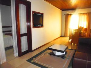 A television and/or entertainment center at Hotel Amazon River