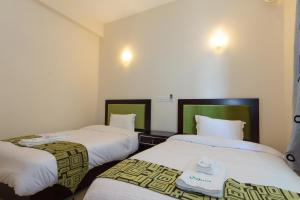Кровать или кровати в номере Supun Arcade Residency