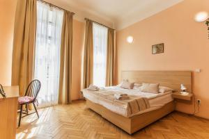 A bed or beds in a room at U Zlate Podkovy - At The Golden Horseshoe
