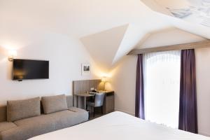Кровать или кровати в номере Best Western City Hotel Woerden
